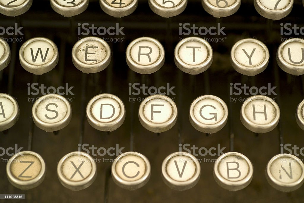 Letters on an antique typewriter keyboard stock photo