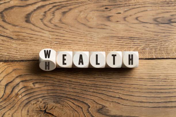 Briefe auf Blöcken, die Wohlstand oder Gesundheit buchstabieren – Foto