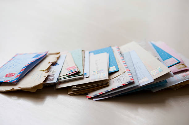 letters on tabletop - mail stock photos and pictures
