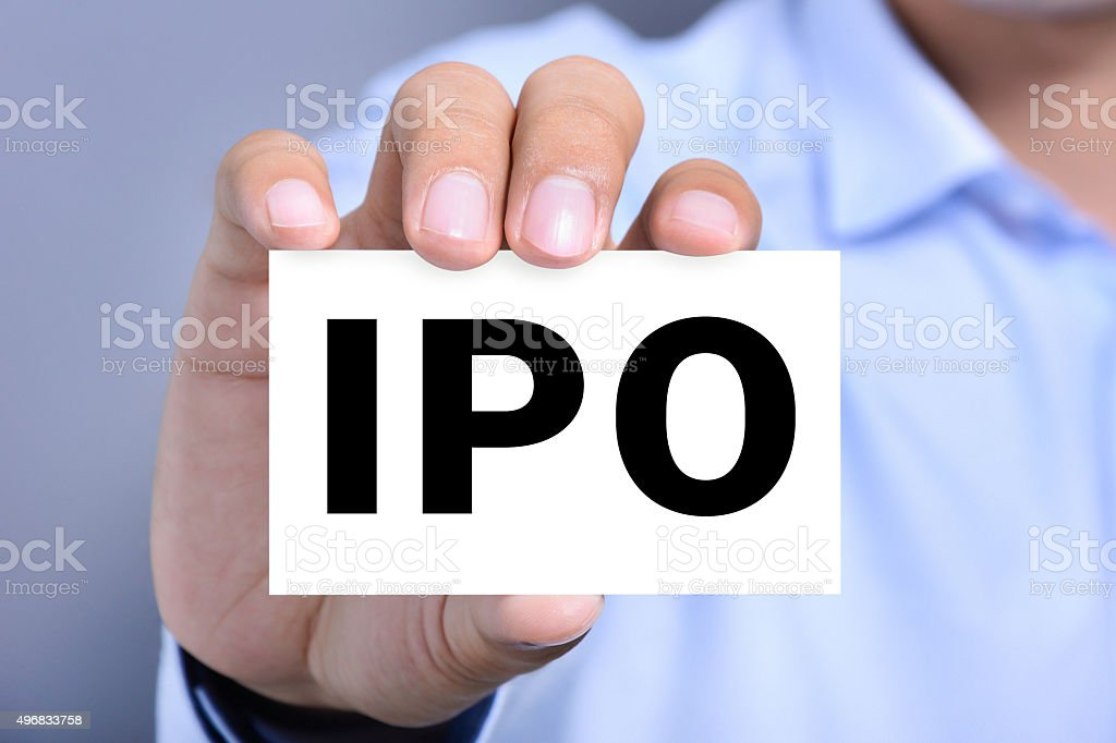 IPO letters  (or Initial Public Offering) on the card stock photo