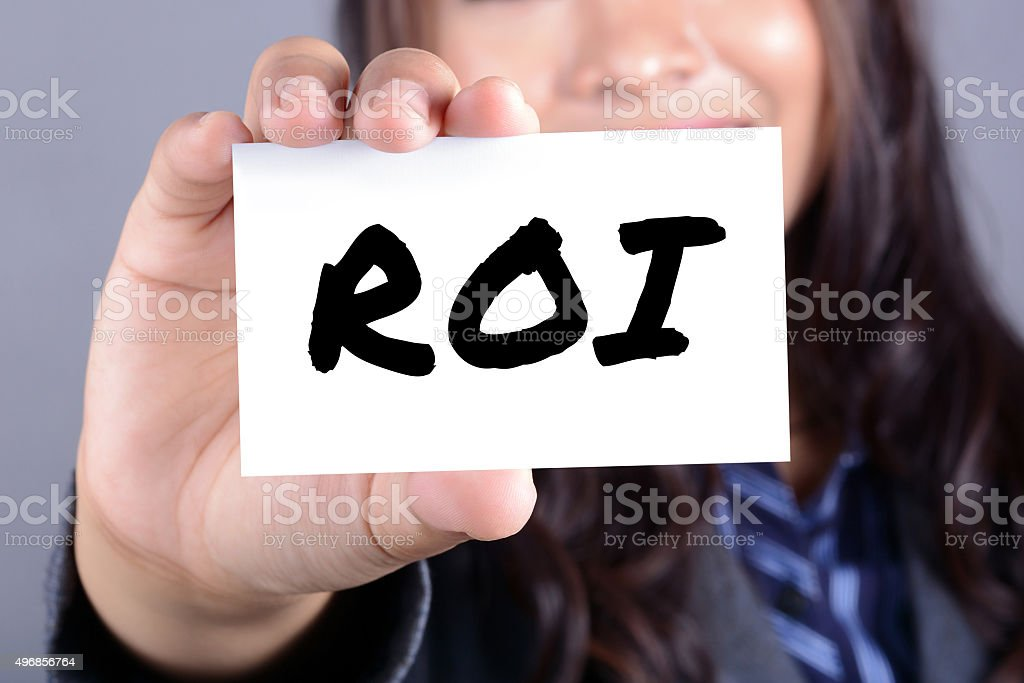 ROI letters (or RETURN ON INVESTMENT) on the card stock photo