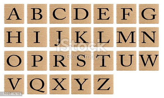 Alphabet letters on wooden tiles isolated on white background.