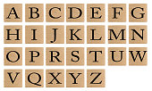 istock Letters on wooden tiles isolated on white background. 1221467674