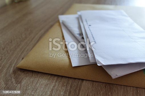 Stack of Letters lying on Table