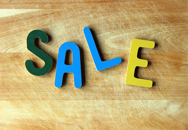 "letters spelling ""sale"" on cutting board - pam schodt stock photos and pictures"