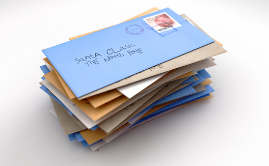 A stack of childrens wish list letters addressed to santa clause in the north pole on an isolated white studio background - 3D render