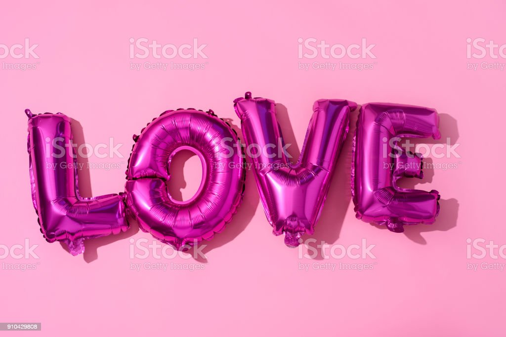 letter-shaped balloons forming the word love stock photo