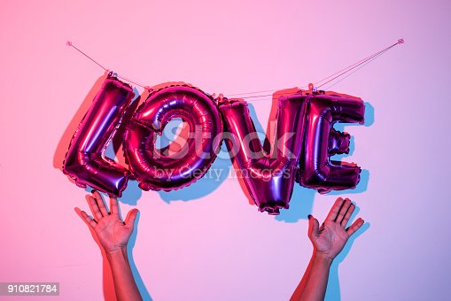 istock letter-shaped balloons forming the word love 910821784