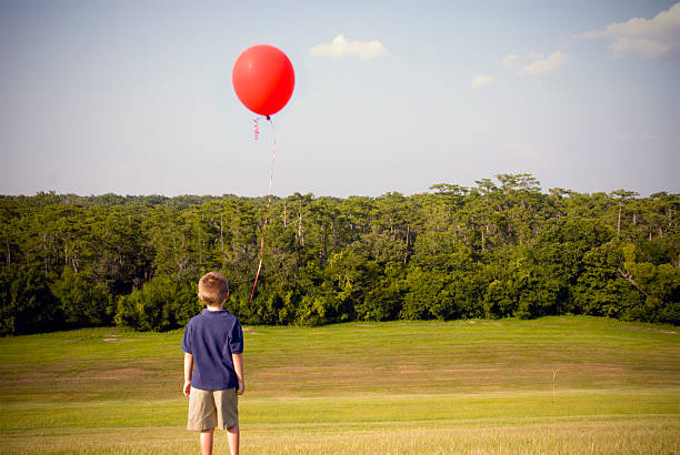 29 Kid Lost Balloon Stock Photos, Pictures & Royalty-Free Images