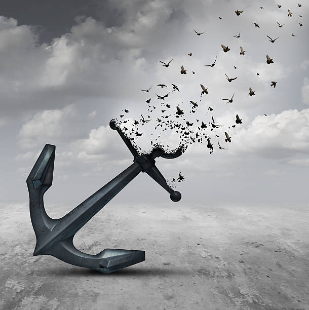 Letting Go Letting go psychology concept as a heavy anchor transforming into a flying group of birds as a motivational metaphor for liberation and leaving a life or business burden behind. detach stock pictures, royalty-free photos & images