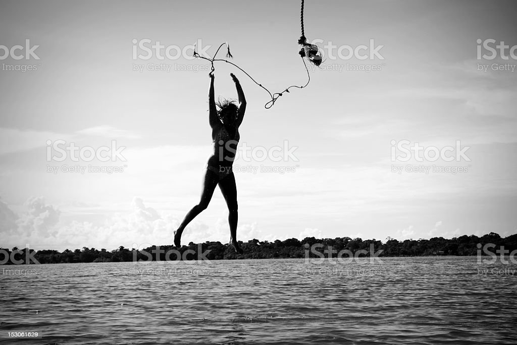 Letting go - young woman dropping into sea royalty-free stock photo