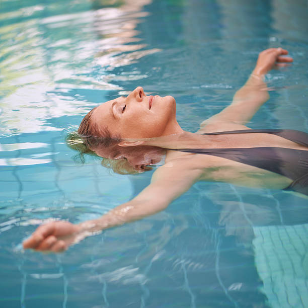 Letting her stress float away stock photo