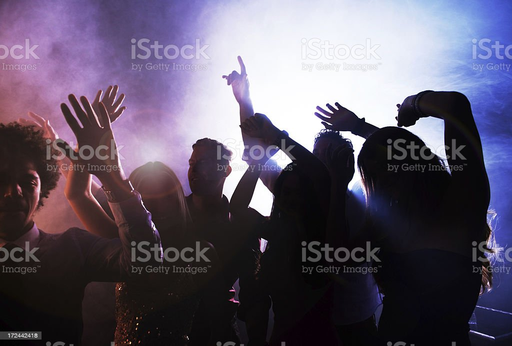 Letting loose on the dance floor stock photo