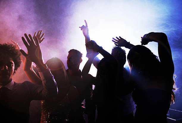 letting loose on the dance floor - dance floor stock photos and pictures
