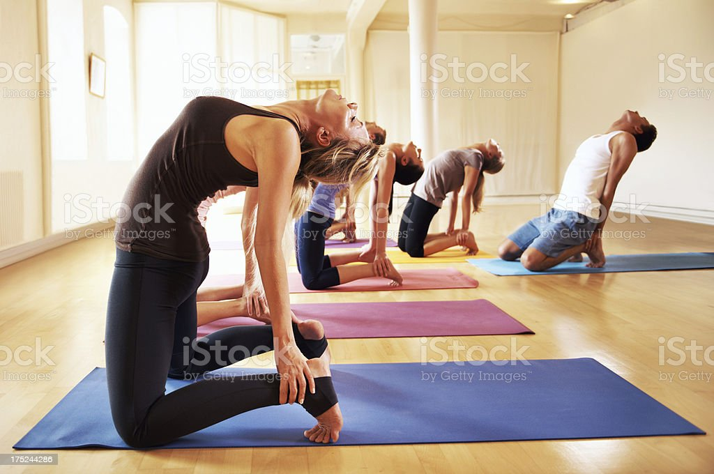 Letting yoga ease their muscles royalty-free stock photo