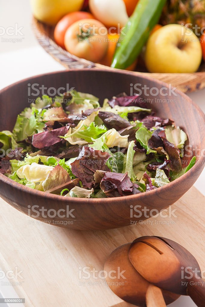 lettuce in wood bowl stock photo