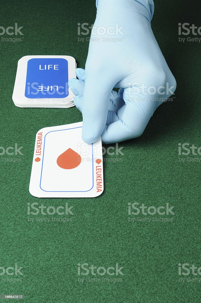 Leukemia card from dealer in surgical glove stock photo