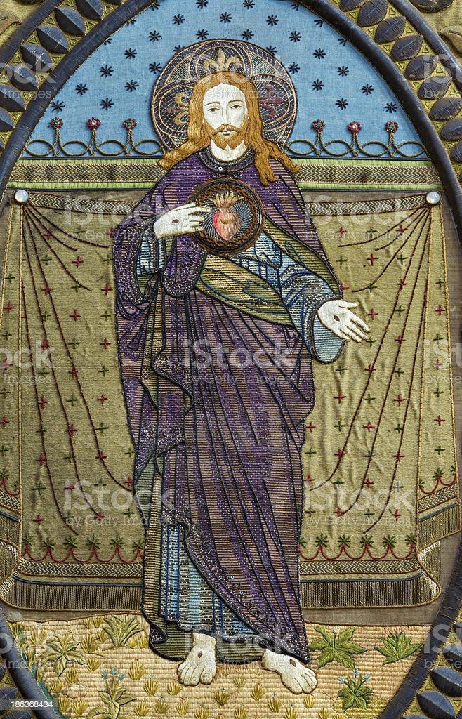 Leuven - Needelwork of Jesus heart on the flag royalty-free stock photo