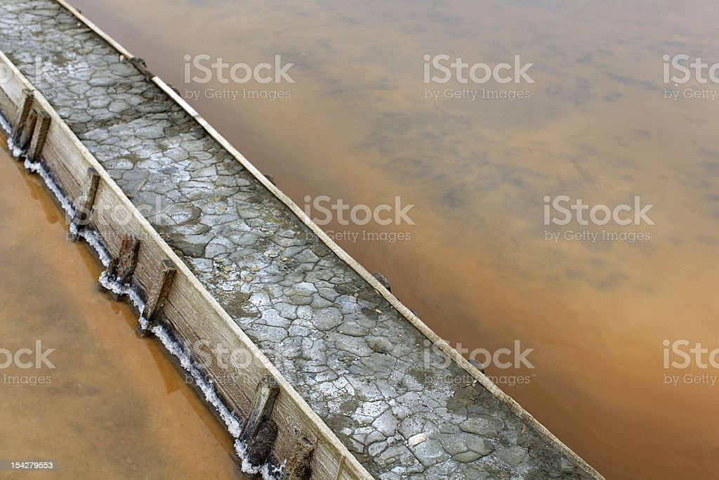 Levee at the salt flats pools filled with brine stock photo