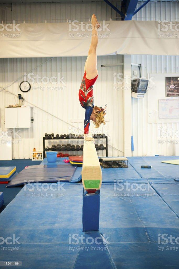 Level 5 Gymnast practicing on Beam stock photo