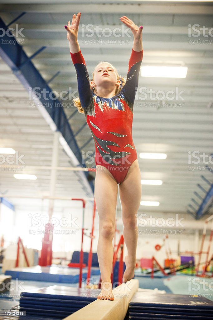 Level five gymnast practicing on beam. royalty-free stock photo