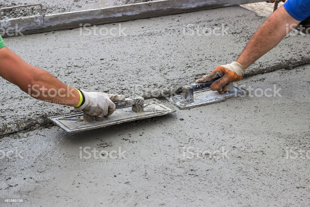 Leveling concrete with trowels stock photo