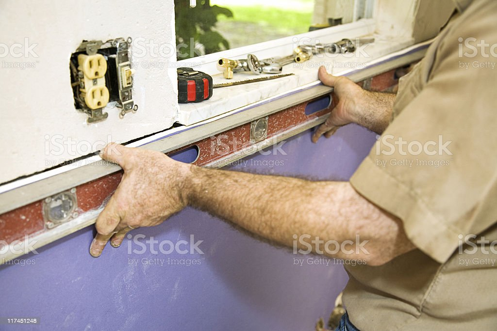 Leveling Drywall royalty-free stock photo