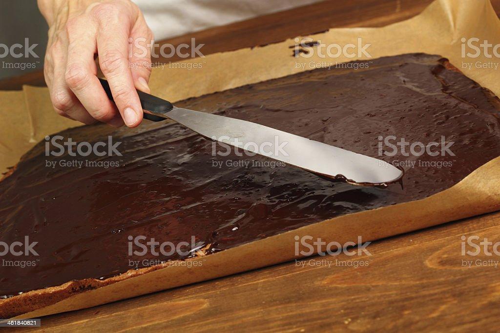 Leveling icing using palette knife stock photo