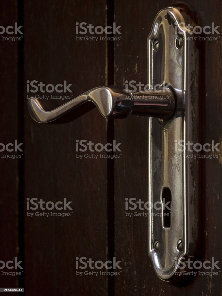 Lever Door Handle on Brown Wooden Door stock photo