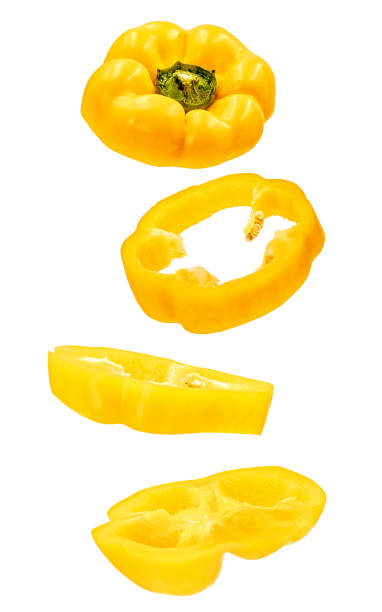 levitating yellow bell pepper slices isolated on white background with clipping path bright yellow bell pepper slices floating in the air isolated on white with clipping path yellow bell pepper stock pictures, royalty-free photos & images