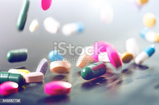 istock Levitation of pills on a black background 545582736