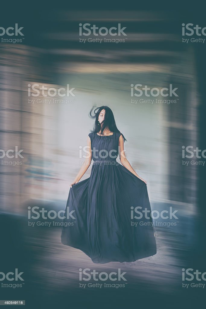 Levitation portrait young woman in house. stock photo