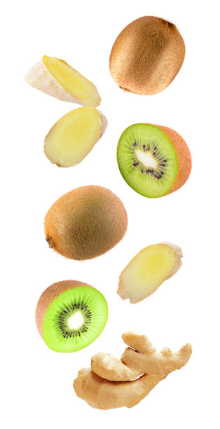 Levity kiwi fruits and ginger floating in the air stock photo