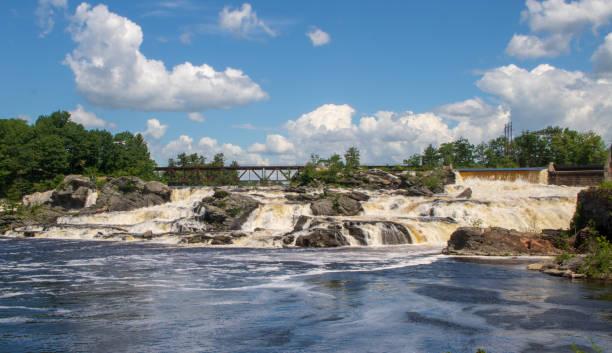 Lewiston Falls and a railroad bridge stock photo