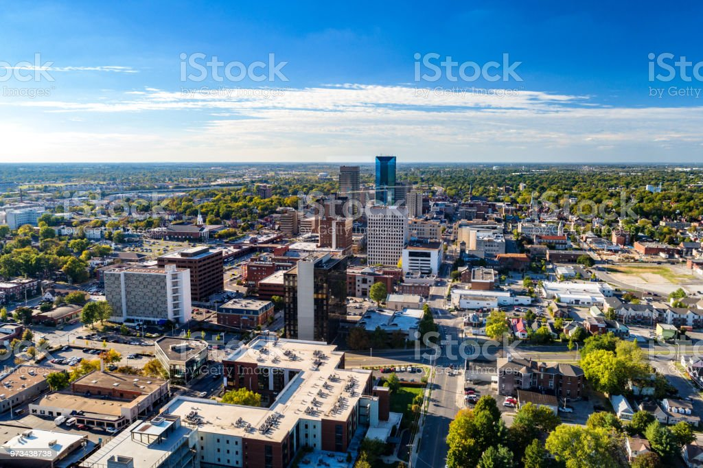 Lexington, KY Downtown Aerial View With Clouds And Blue Sky Aerial view of Downtown Lexington, Kentucky with a blue sky with clouds and the metropolitan area cityscape in the background. Aerial View Stock Photo