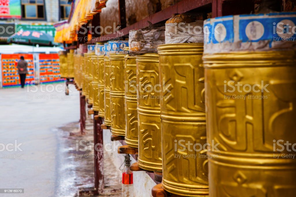 Lhasa scenery-Prayer wheels at the foot of the Potala Palace Mountain stock photo