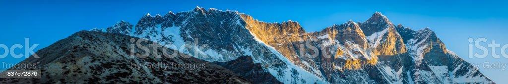 Lhotse 8516m Nuptse 7861m golden dawn Himalaya mountains panorama Nepal stock photo