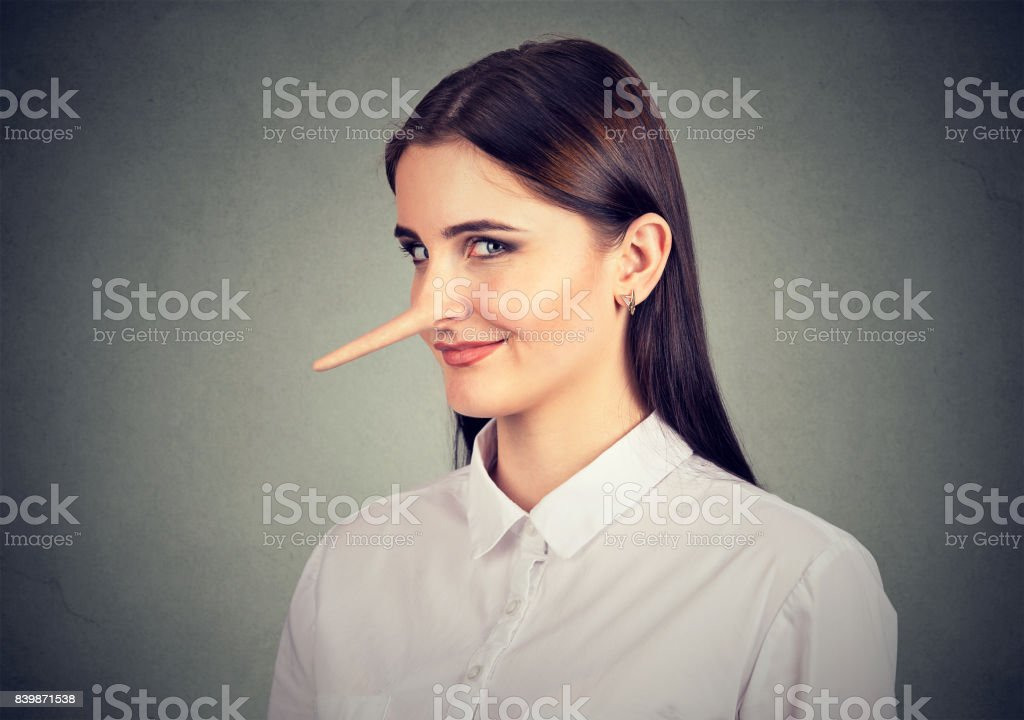 Liar sly funny looking young woman stock photo
