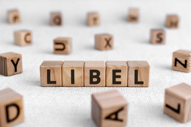 libel - words from wooden blocks with letters - defame stock pictures, royalty-free photos & images