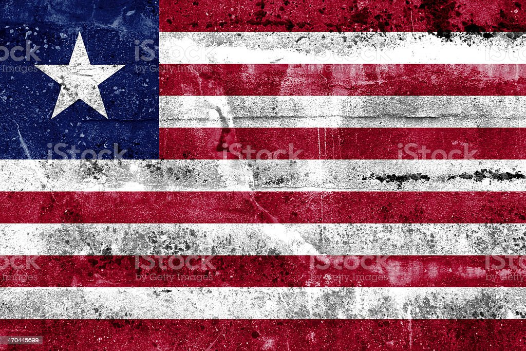 Liberia Flag painted on grunge wall stock photo