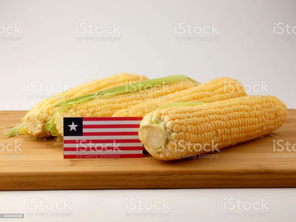 Liberian flag on a wooden panel with corn isolated on a white background stock photo