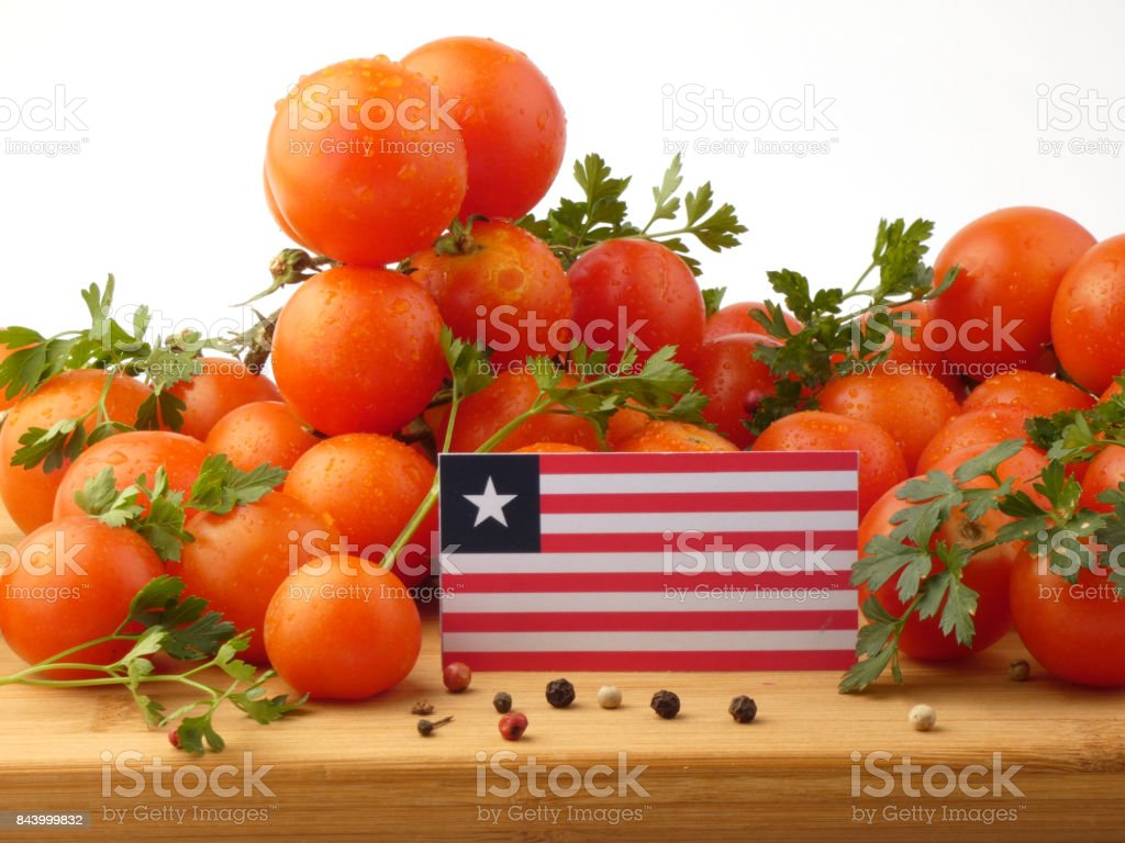 Liberian flag on a wooden panel with tomatoes isolated on a white background stock photo
