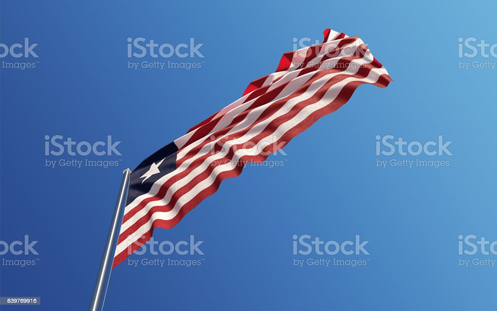 Liberian Flag Waving With Wind On Blue Sky stock photo