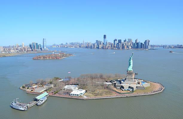 Liberty and Ellis Island with Manhattan Skyline stock photo