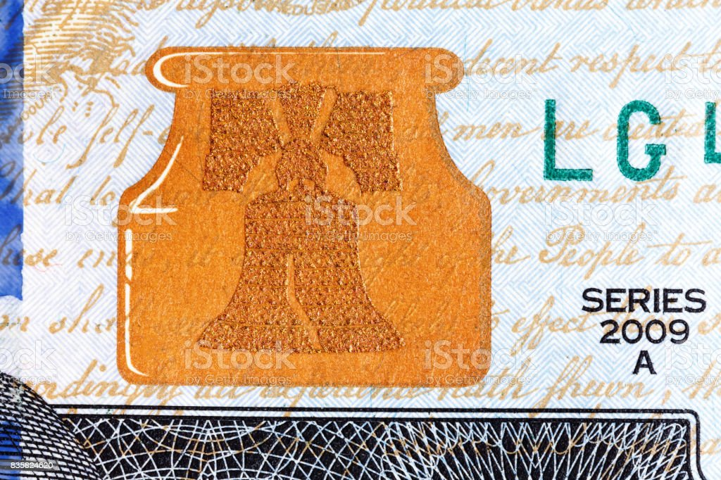 Liberty Bell U.S. currency one hundred dollar bill stock photo
