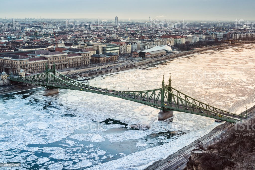 Liberty bridge and the icy Danube river stock photo