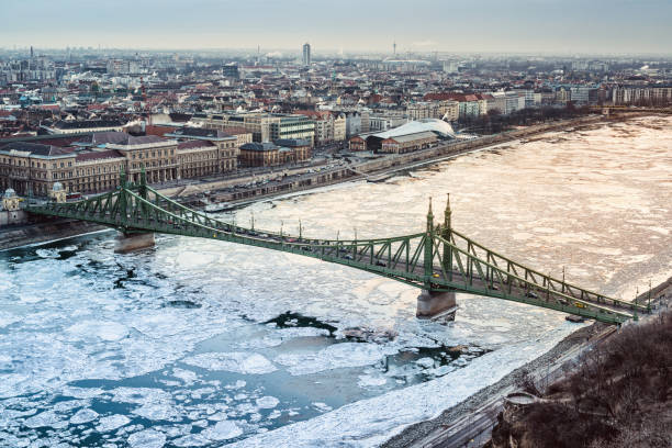 Liberty bridge and the icy Danube river Liberty bridge and the icy Danube river liberty bridge budapest stock pictures, royalty-free photos & images