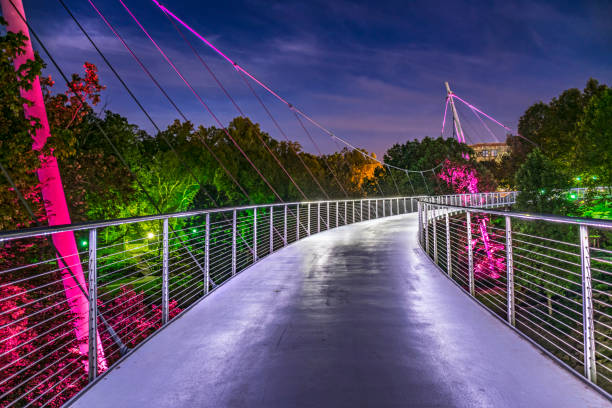 Liberty Bridge in Downtown Greenville, South Carolina Illuminated Liberty Bridge in Downtown Greenville, South Carolina SC. liberty bridge budapest stock pictures, royalty-free photos & images