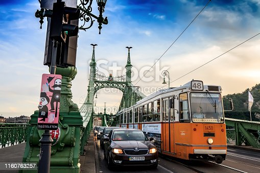 Budapest, Hungary - 15 June 2019: Liberty Bridge with riding tram and cars