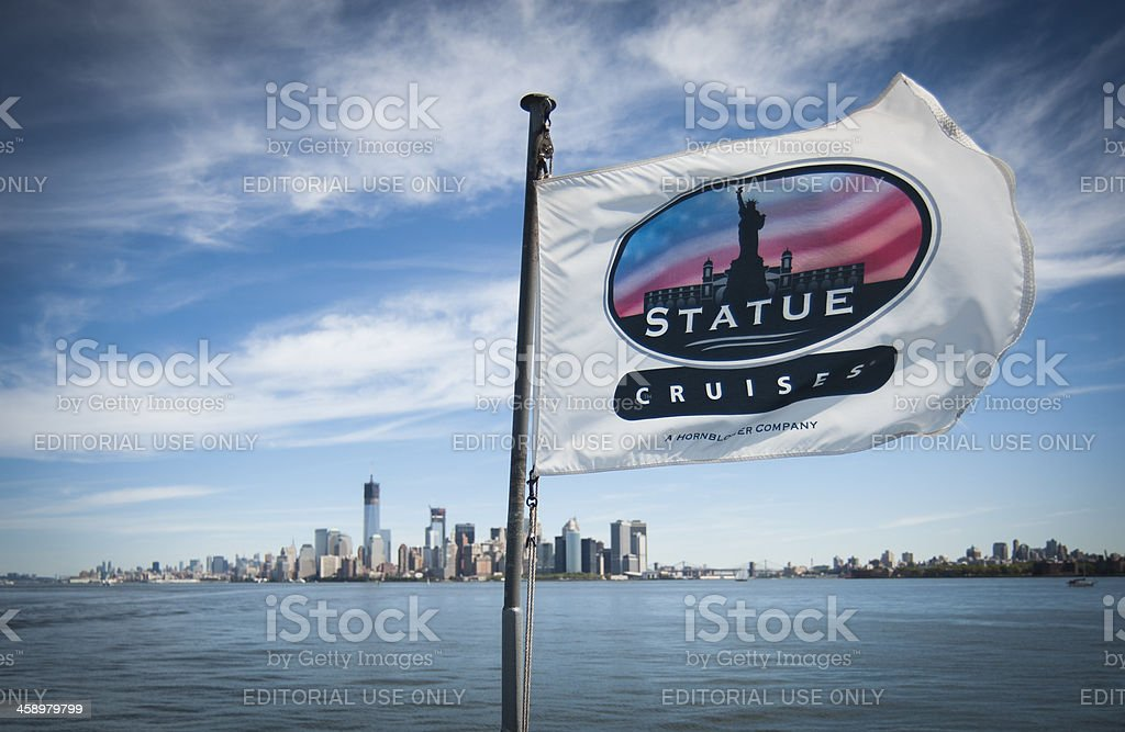 Liberty Island cruises with NYC in the background royalty-free stock photo